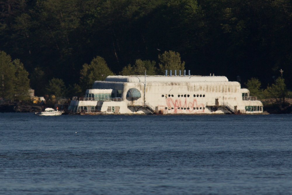 This is known as the McBarge, and actually was a McDonald's restaurant at Expo '86. It looks shimmery due to heat and distance.