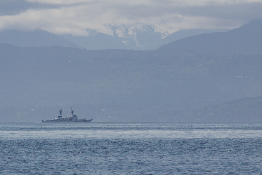 Looking south across the Strait of Juan de Fuca at Washington State and a US Coast Guard ship.